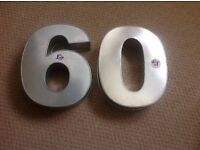 Numbers 6 and 0 large stainless cake tins