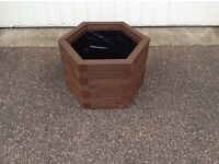 Soft wood lined six sided wooden planter