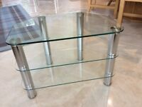 Television stand with chrome legs and three glass shelves, as new, ex John Lewis .