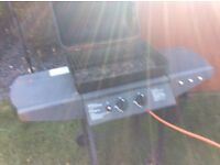 Gas BBQ with full gas cylinder