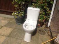 Close couple press button white toilet suite