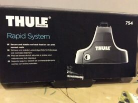 Thule load bars and foot 754and kit . Used once . Have receipt . Like brand new