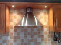 Black ceramic hob and stainless steel cooker hood