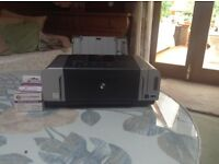 Cannon printer in original box with instructions. In as new condition working perfectly.