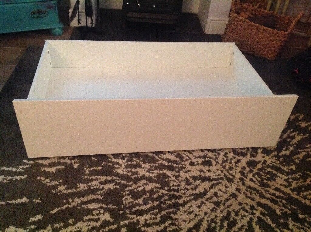 White Ikea under bed storage drawers on castors