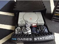 PlayStation 1, 2 controllers and games in storage case