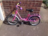 Girls Pink 'PUKY' bicycle.