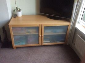 Ikea beech effect glass fronted tv cabinet.