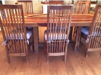 Beautiful solid wood seasham dining table and 8 chairs.