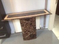 Two marble console tables £60 each brown and cream 1with black &awhile top lovely for hall, landing.