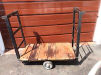 Grange metal trolley wooden base 3 foot x 20 inch. Very easy to maneuver.