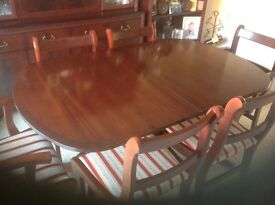 Extending dining table and 7 chairs