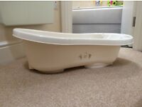 Cream baby bath tub with built in support