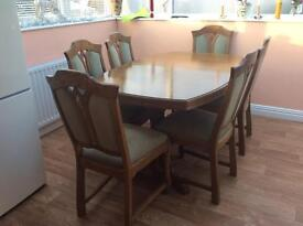 Solid oak extending dining room table and six chairs