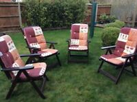 Four wooden reclining garden chairs with covers, good condition, sturdy. 3 reclining positions.