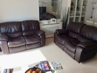 Two identical dark brown Leather recliner sofas.