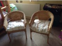 Pair of chairs. Whicker with cushioned seats.