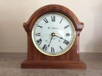 Wooden cased battery clock, keeps excellent time.