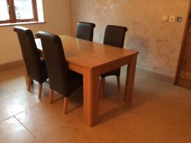 Chunky wooden dining table and 4 brown leather chairs