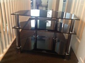 Black glass TV stand would do 30 to 40inch tv , great condition