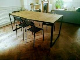 Wooden dining table with six chairs