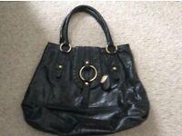 Tula black leather shoulder bag