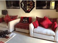 2 snuggle couches and pouffe for sale