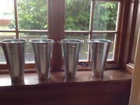Set of four metal plant pots