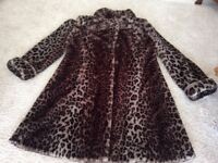 Lady's luxurious Animal Print 3/4 length coat 16/18. Perfect for the elegant look