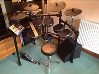 Alesis DM10 mesh electronic drum kit with bass pedal, practice amp, stool and sticks