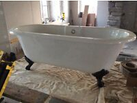 New and unused Freestanding Acrylic rolltop bath with cast iron feet
