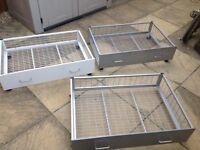 Metal Under bed storage on wheels 3 no available 2 silver 1 white 1 broken wheel as in picture