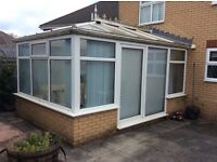 Rehau UPVC conservatory with polycarbonate roof