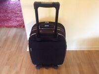 Medium Sized Black Voyager Trolley Suitcase.