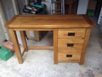 Oak furniture land dressing tables with three drawers