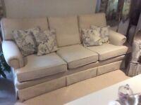 Large three seater cream sofa