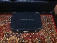 Vintage suitcase for sale. Needs repair.