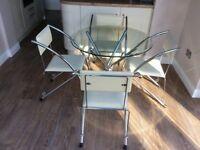 Modern glass topped dining table and 4 chairs