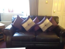 2 Dark Brown leather sofas & 1 chair bought from Reid's. £300