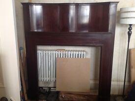 Large mahogany fireplace.