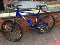 Gents blue GT bike unused for some time needs recommissioning