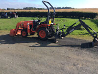 Kubota 2230 Compact tractor with front end loader and rear back hoe