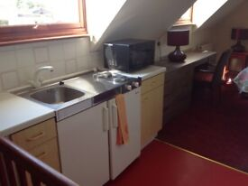 Sunny first floor studio with kitchenette and ensuite shower room £250 pm (£57.69p per week)