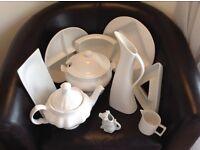 New/unused 10 piece white ceramic ware dishes