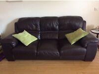 Three-seater brown leather sofa.