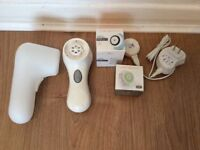Clarisonic with three new spare brushes