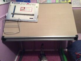 Tiltable drawing board desk with lamp and adjustable height