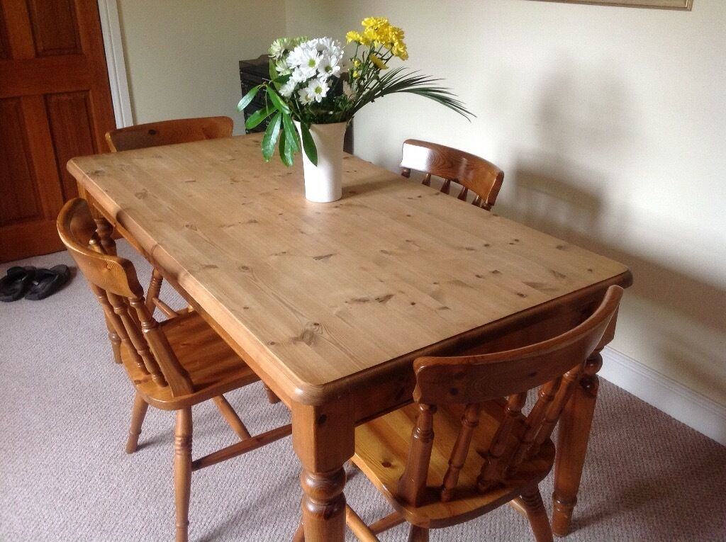 farmhouse kitchen table and four chairs. farmhouse kitchen table and four chairs. scrub clean surface. chairs