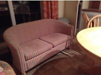Pretty two seater sofa ideal for small room or bedroom