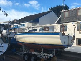 Fox Terrier 22 roomy fast cruiser with knott trailer 5hp Yamaha and full inventory for sailing VGC
